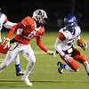 West Brook Bruin Will Gavrelos, 4, runs for a gain against the Manvel Mavericks at the Stallworth Stadium in Baytown November 14, 2014. Photo by Drew Loker.