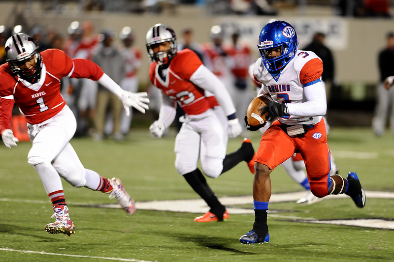 West Brook Bruin Demarcus Smith, 3, finds an opening against the Manvel Mavericks at the Stallworth Stadium in Baytown November 14, 2014. Photo by Drew Loker.