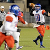West Brook Bruin QB Justin Essex, 10, looks for an open receiver against the Manvel Mavericks at the Stallworth Stadium in Baytown November 14, 2014. Photo by Drew Loker.