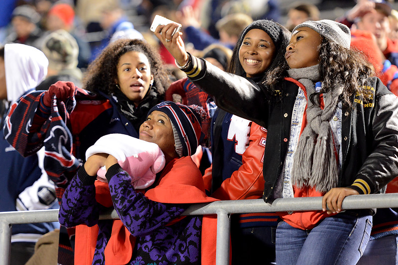 West Brook Bruin fans pause for a group selfie while bundled up for the cold weather match against the Manvel Mavericks at the Stallworth Stadium in Baytown November 14, 2014. Photo by Drew Loker.