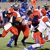West Brook Bruin QB Justin Essex, 10, runs for short yardage against the Manvel Mavericks at the Stallworth Stadium in Baytown November 14, 2014. Photo by Drew Loker.