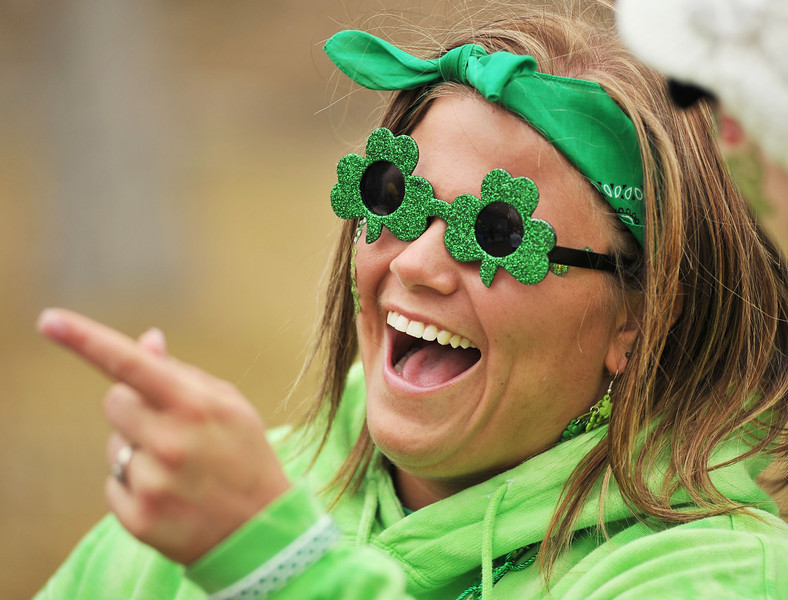 """Mindee Rieger points to the band shell as race preparations are made during the Sheridan Jaycees """"Run 'Till You're Green"""" fun run event at Kendrick Park."""