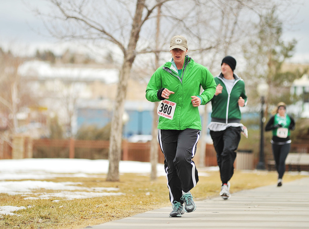 """Molly Boyer leads a group of 5K runners at Whitney Commons during the Sheridan Jaycees """"Run 'Till You're Green"""" fun run event."""