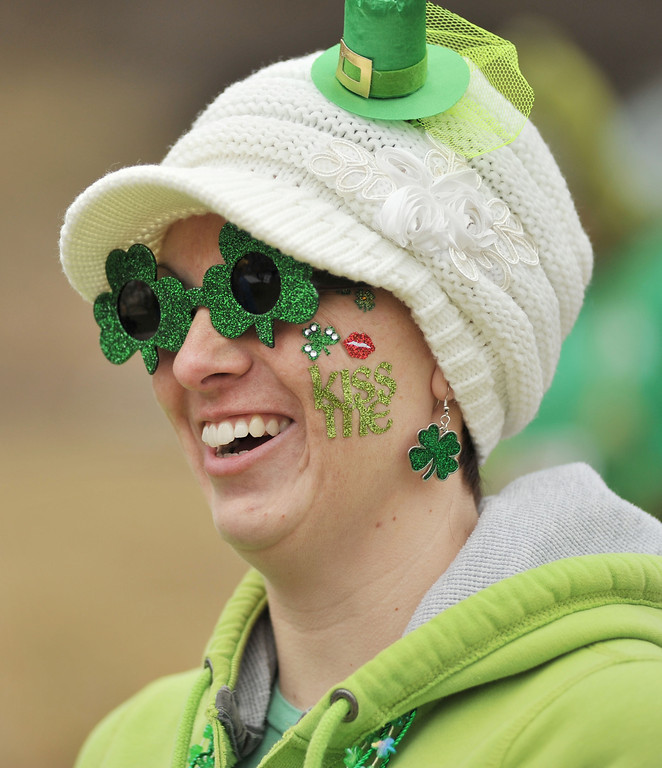 """Kayla Morris waits with her friends as race preparations are made during the Sheridan Jaycees """"Run 'Till You're Green"""" fun run event at Kendrick Park. Morris won a prize for the 'Greenist' dressed outfit."""