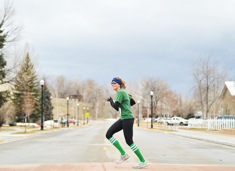 """Jennifer Drake of Clearmont crosses Jefferson Street during the Sheridan Jaycees """"Run 'Till You're Green"""" fun run event. Drake finished 2nd in the 5K race."""