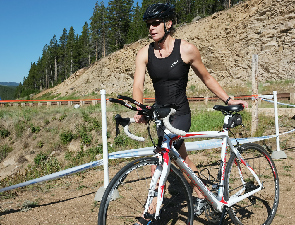 Triathlon competitor Jen Reiter replaces her bike after the road race to transition to the trail run during the Sibley Lake Triathlon and Duathlon Saturday morning at Sibley Lake near Highway 14 in the Bighorn Mountains. Reiter placed third in the triathlon. The Sheridan Press|Justin Sheely.