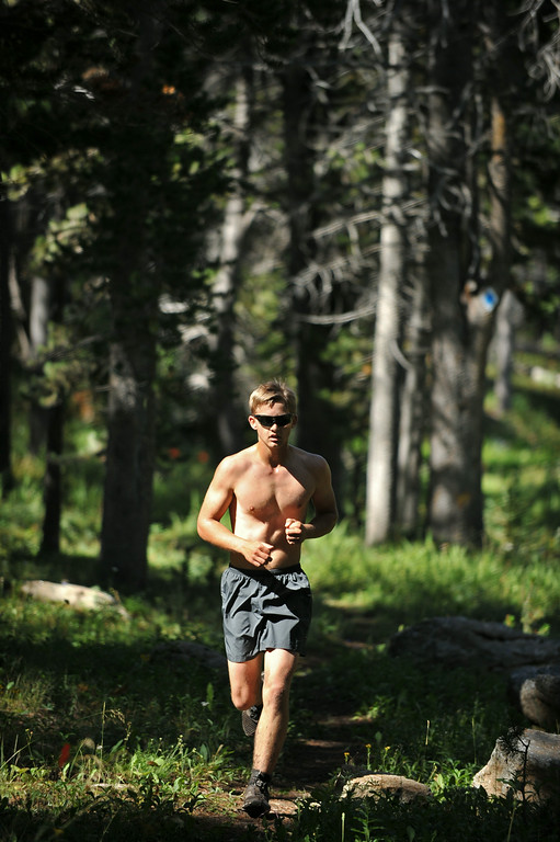 Duathlon competitor Taylor Wendland runs through the forest for the homerun of the Sibley Lake Triathlon and Duathlon Saturday morning at Sibley Lake near Highway 14 in the Bighorn Mountains. Wendland finished strong for second place.  Proceeds from the event benefits the Sheridan Area Search and Rescue. The Sheridan Press|Justin Sheely.