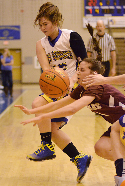 Sheridan's Emily Julian and a Laramie defender collide on the court Saturday afternoon at Sheridan High School.