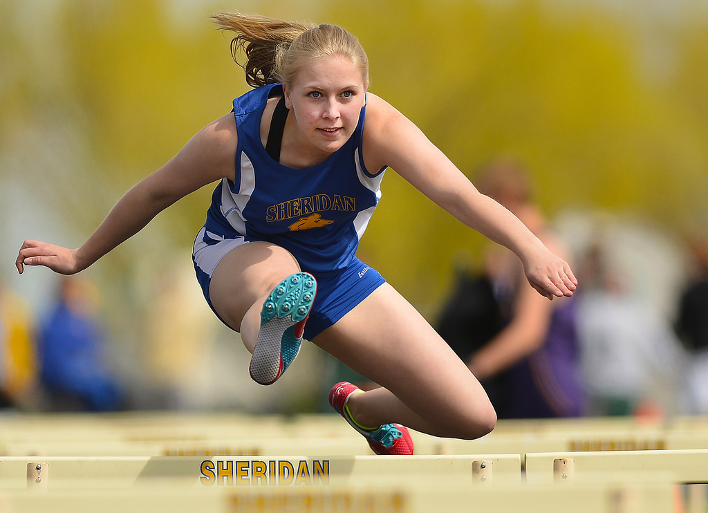 Sheridan's Kelsey Walton competes in the Girls' 100-Meter Hurdles during the Dan Hansen Invitational Saturday at Sheridan High School. The Sheridan Press|Justin Sheely