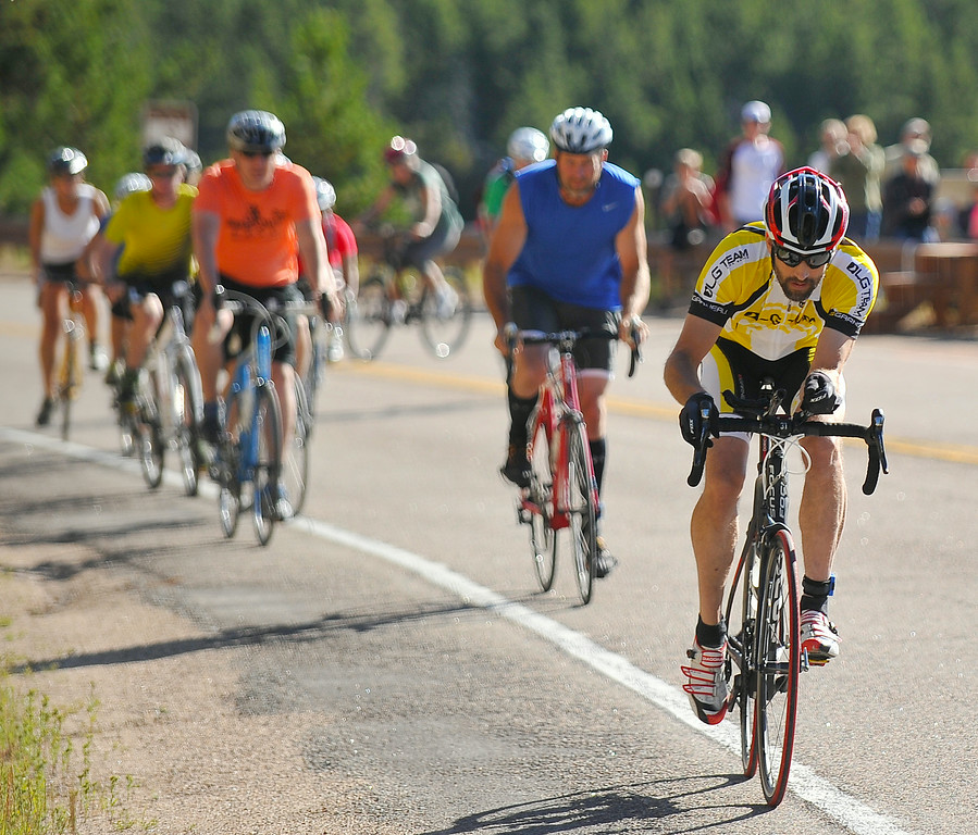 Kameron Condos pulls ahead of the group of bicyclists for the duathlon on Highway 14 during the Sibley Lake Triathlon and Duathlon Saturday morning. Condos kept his lead to finish first place in the duathlon. The Sheridan Press|Justin Sheely.