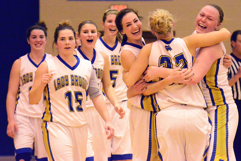 Lady Broncs players celebrate after their 55-54 win over No. 1 Natrona Saturday afternoon at Sheridan High School. (The Sheridan Press/Brad Estes)