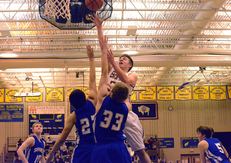 Judson White scores over Billings Skyview defenders during the Broncs 67-61 win Friday night at Sheridan High School. White finished with 19 points. (The Sheridan Press/Brad Estes)