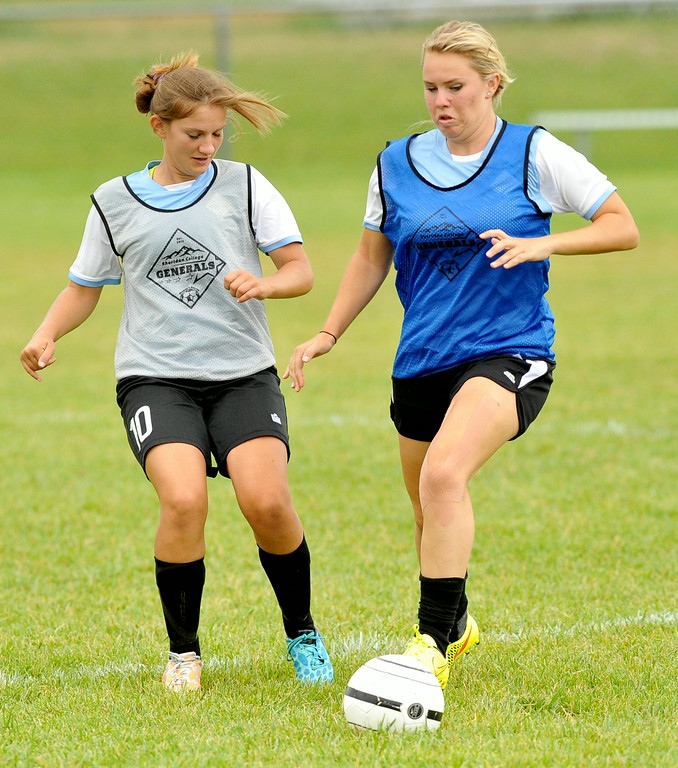 Tina Brown, left, and Mackenzie Muir battle for possession during Sheridan College soccer practice on Friday at Maier Field. The Sheridan Press|Mike Pruden