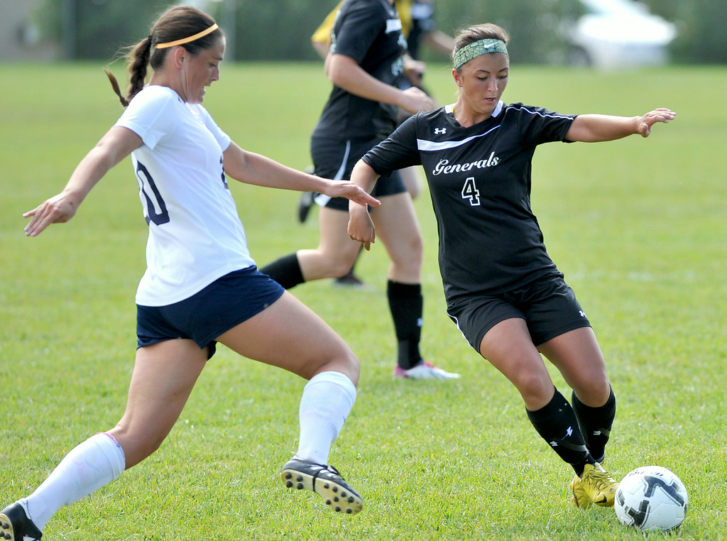Peyton Dean, right, looks to pass the ball by the defender on Friday at Maier Field. The Sheridan Press|Mike Pruden