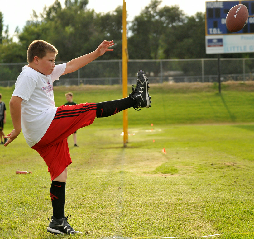 Josh Thompson, 10, punts the ball during the NFL Punt, Pass, and Kick competition on Wednesday at Madia Football Field. The Sheridan Press|Mike Pruden