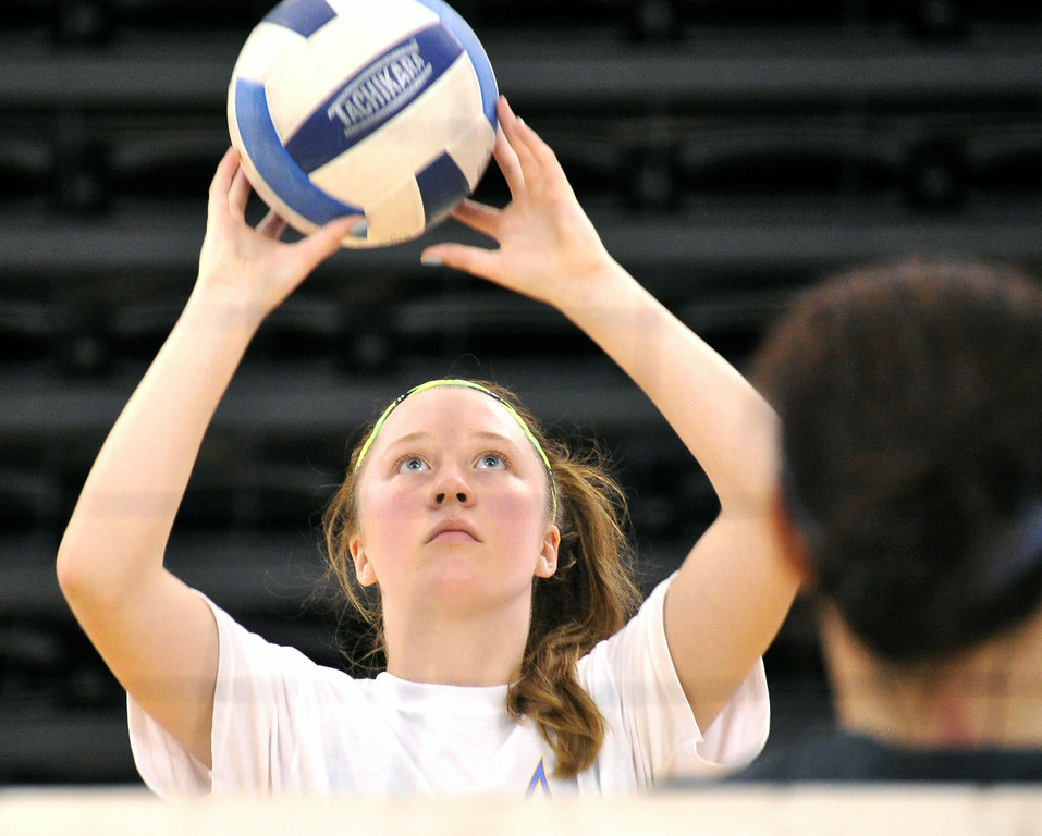 Kairstyn Holden sets the ball during the Sheridan College Volleyball Camp on Tuesday at the Golden Dome. The Sheridan Press|Mike Pruden