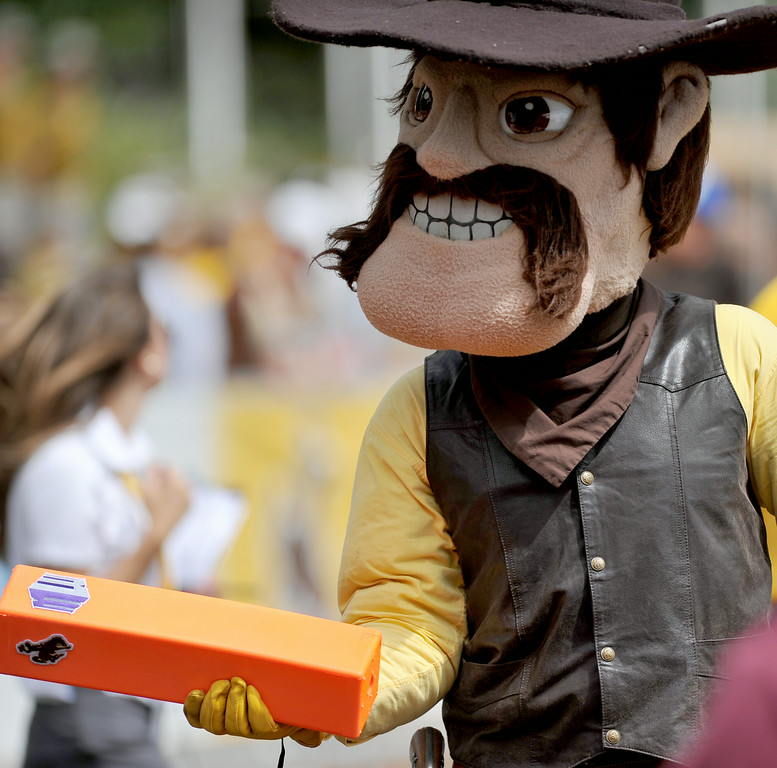 Pistol Pete uses a pylon to flex his muscles for the crowd before the start of the University of Wyoming's season opener on Saturday at War Memorial Stadium. The Sheridan Press|Mike Pruden