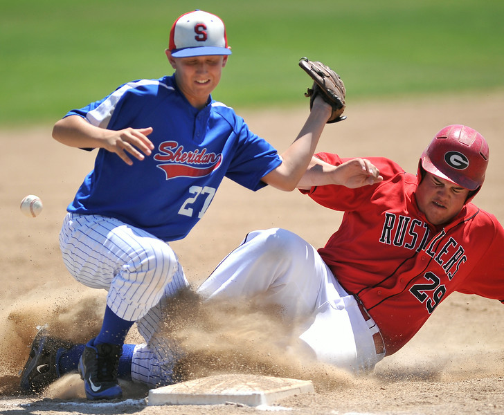 Gillette's Derek Hocker, right, colides with Sheridan Babe Ruth All-Stars third baseman Caleb Keller on a steal attempt during round one of the Legion 'B' State Tournament on Thursday at Thorne-Rider Stadium. The Sheridan Press|Mike Pruden