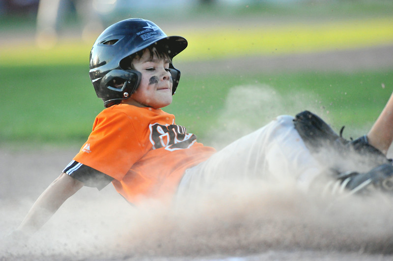 Trace Dobson slides safely into third base during on Tuesday at the 6th Street Fields. Dobson and the Orioles won the Webb Wright Minor League Championship, beating the Marlins 7-0. The Sheridan Press|Mike Pruden