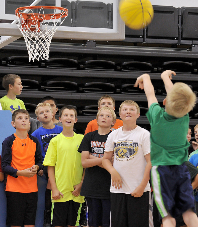 Campers cheer on a teammate during a shooting contest during the Sheridan College Boys Basketball Camp Wednesday at the Bruce Hoffman Golden Dome. The Sheridan Press|Mike Pruden