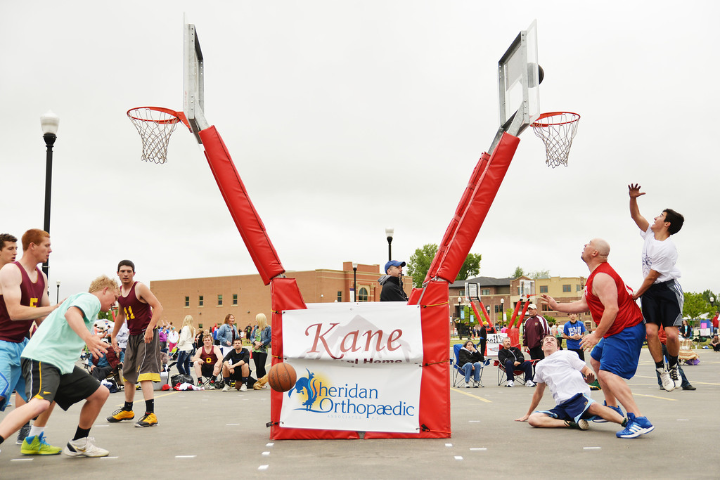 Men play in 3-on-3 basketball during the Wyoming Rehab Hoop Jam Saturday at Whitney Plaza. Justin Sheely|The Sheridan Press