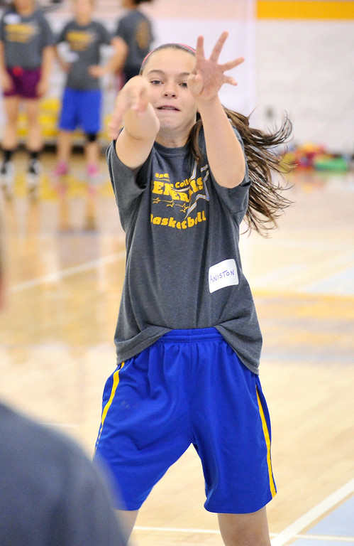 Aniston Beard, 11, passes the ball during a drill at camp on Thursday at the Bruce Hoffman Golden Dome. The Sheridan Press|Mike Pruden