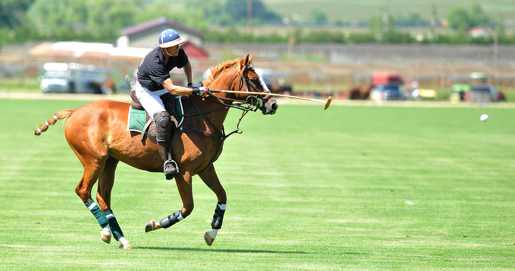 Pony Grill & Bar's Richard Dudman hits the ball toward his goal on Sunday at the Big Horn Equestrian Center. The Sheridan Press|Mike Pruden