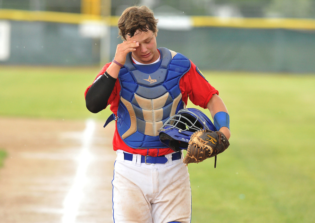 Sheridan Troopers catcher Matt Mullinax wipes the sweat from his brow on Sunday at Thorne Rider Stadium. The Sheridan Press|Mike Pruden