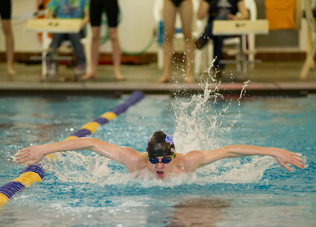 Presley Felker wins the 100-meter butterfly with a time of 1:07.79 over Buffalo Friday night at the Sheridan Junior High School pool.