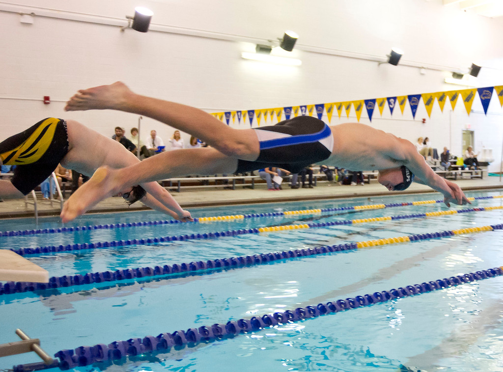 Wayde Phelps jumps off the block during the 400-meter freestyle against Buffalo Friday Friday at Sheridan Junior High School.