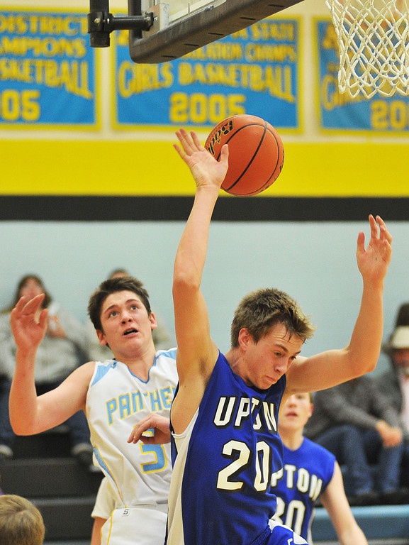 Dawson Bell, left, fouls a Bobcat shot in the first half of the Panther's home game Friday at Arvada-Clearmont School.