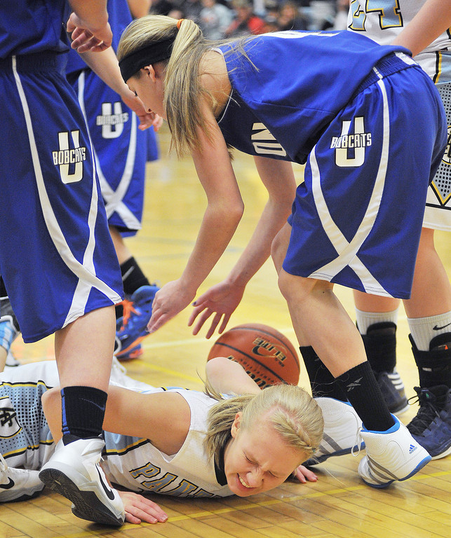 Lady Panthers' senior Shayna Kretschman takes a spill after driving the ball up the court Friday at Arvada-Clearmont School. The Lady Panthers fell to the Upton Lady Cats 25/54.