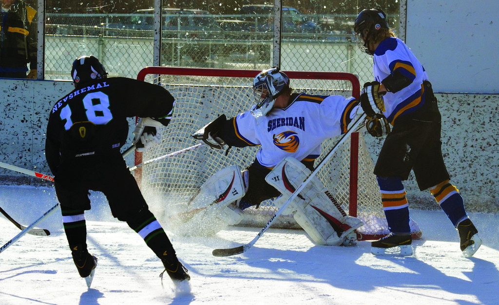 Laramie Outlaw Anthony Nevshemal takes a shot against Sheridan Hawks' goalie Chris Jairell during Laramie's 8-4 win over Sheridan Saturday morning at Sheridan Ice. Alisa Brantz|The Sheridan Press.