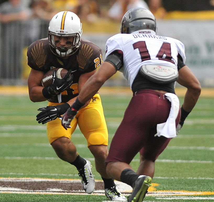 Wyoming runningback Shaun Wick shakes a tackler on Saturday at War Memorial Stadium. Wick scored the Cowboys' first touchdown of the game on the way to a 17-12 win over Montana. The Sheridan Press|Mike Pruden