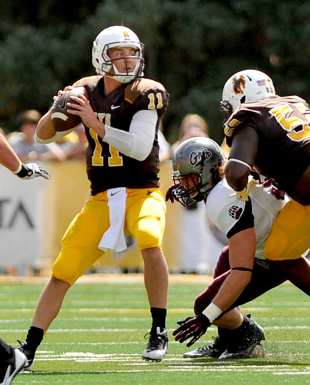 Quarterback Colby Kirkegaard drops back to pass during the first quarter of Wyoming's 17-12 win over Montana on Saturday at War Memorial Stadium. The Sheridan Press|Mike Pruden