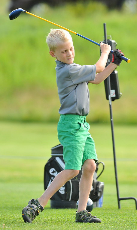 Connor Bateson, Sheridan, takes a big cut on his drive while competing in the boys 7-9 age group at the Drive, Chip, & Putt contest on Sunday at the Powder Horn. The Sheridan Press|Mike Pruden