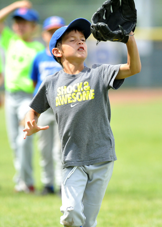 Dane Steel, 7, preps himself to catch a fly ball at the Trooper Baseball Camp on Thursday at Thorne-Rider Stadium. The Sheridan Press|Mike Pruden