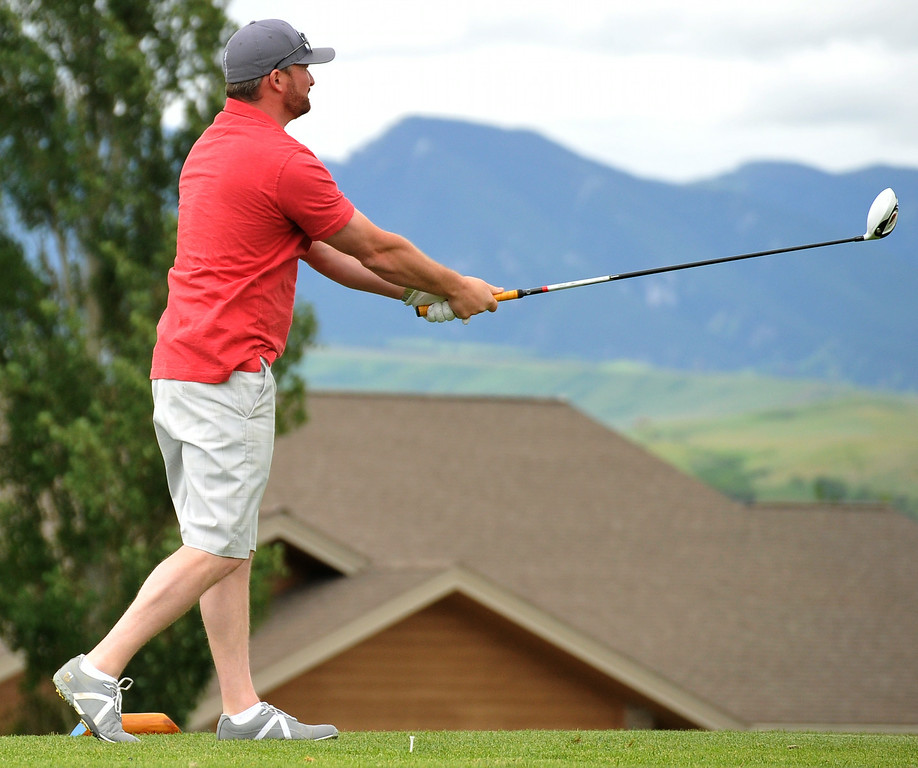 Joe Prosenick poses after hitting a big drive during the Chris LeDoux Spurs and Spikes Memorial Golf Tournament on Saturday at the Powder Horn. The Sheridan Press|Mike Pruden