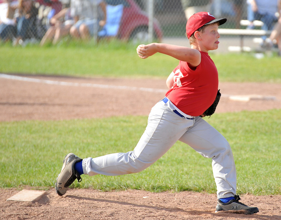 Jim Strobbe winds up to pitch for the Reds in the 5th and 6th grade division of the Webb Wright Baseball League on Tuesday at Oatts 6th Street Field. The Sheridan Press|Mike Pruden