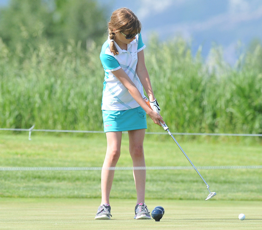 Ellie Williams, Big Horn, putts the ball during the Drive, Chip & Putt contest on Sunday at the Powder Horn. The Sheridan Press|Mike Pruden