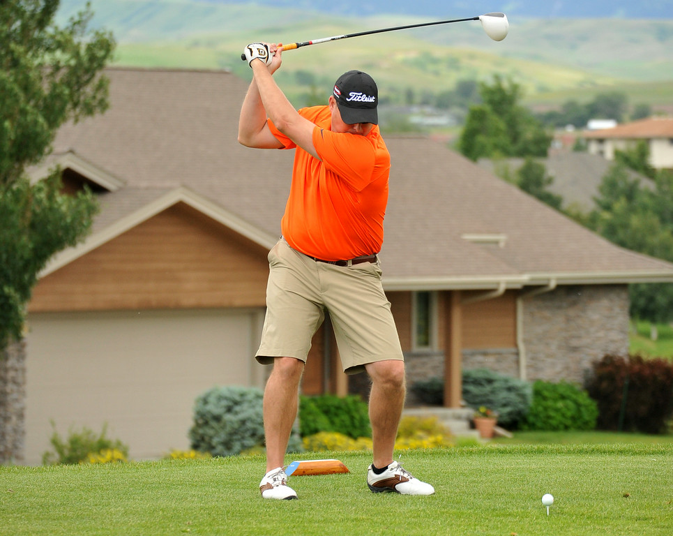 Matt Gipson takes a big swing during the Chris LeDoux Spurs and Spikes Memorial Golf Tournament on Saturday at the Powder Horn. The Sheridan Press|Mike Pruden