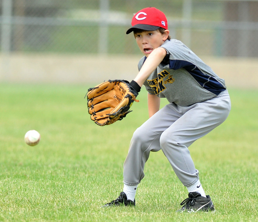 Shane Karajanis, 12, fields a ground ball at the Trooper Baseball Camp on Thursday at Thorne-Rider Stadium. The Sheridan Press|Mike Pruden