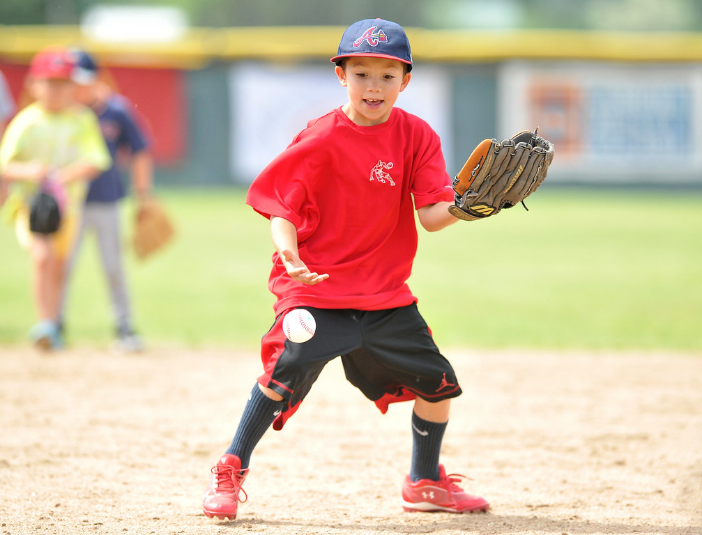 Joel Padilla, 8, fields a ball of the hop at the Trooper Baseball Camp on Thursday at Thorne-Rider Stadium. The Sheridan Press|Mike Pruden