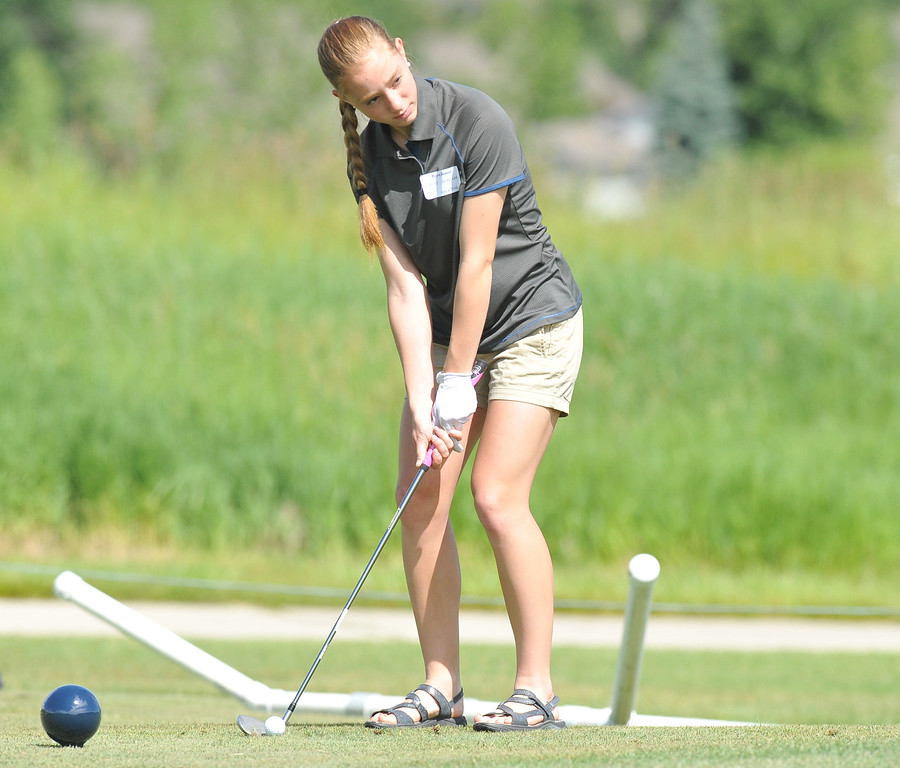 Peyton Bomar, Sheridan, eyes the green before her chip during the Drive, Chip & Putt contest on Sunday at the Powder Horn. The Sheridan Press|Mike Pruden