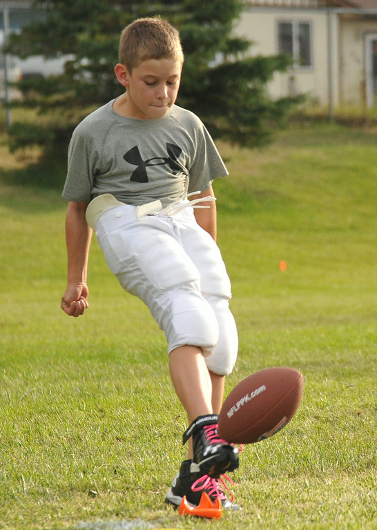 Ten-year-old Jack Walker kicks the ball off the tee during the NFL Punt, Pass, and Kick competition on Wednesday at Madia Football Field. The Sheridan Press|Mike Pruden