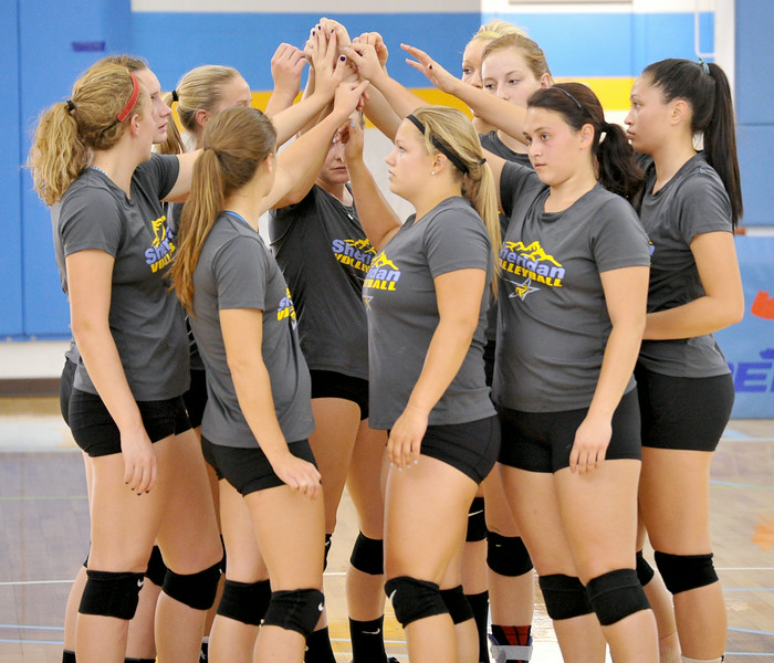 The Sheridan College Volleyball Team huddles up before a drill on Friday at the Bruce Hoffman Golden Dome. The Sheridan Press Mike Pruden