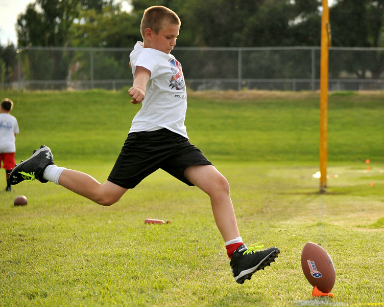 CJ Koval, 11, winds up to kick the ball at the NFL Punt, Pass, and Kick competition on Wednesday at Madia Football Field. The Sheridan Press Mike Pruden
