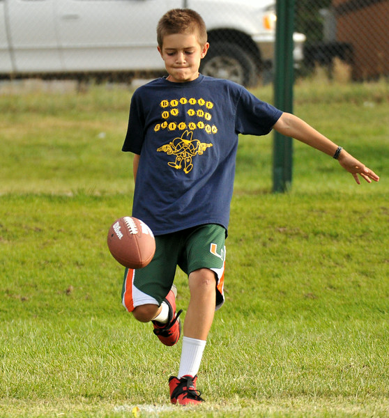 Eleven-year-old Robert Morton keeps his eye on the ball before his punt during the NFL Punt, Pass, and Kick competition on Wednesday at Madia Football Field. The Sheridan Press Mike Pruden
