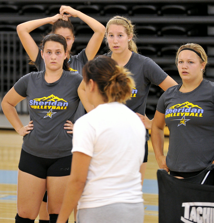 Lady Generals head coach Jennifer Stadler explains a drill to her volleyball team during practice on Friday at the Bruce Hoffman Golden Dome. The Sheridan Press|Mike Pruden