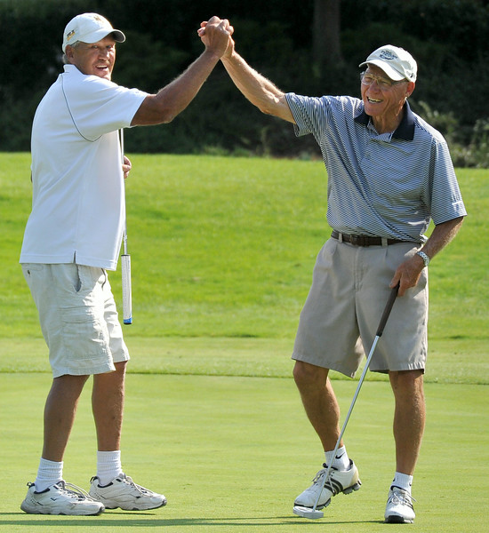 Craig Hanson, left, congratulates his teammate Bruce Holwell after Holwell drained a long birdie putt on the 9th green during the Rocky Mountain Pro-Am on Monday at the Powder Horn. The Sheridan Press Mike Pruden